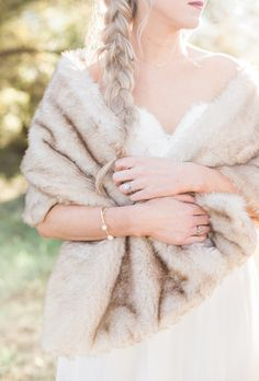A fur shawl for the bride: http://www.stylemepretty.com/california-weddings/2016/01/21/an-event-coordinators-dreamy-organic-romantic-backyard-wedding/ | Photography: Daphne Mae - http://www.daphnemaephotography.com/