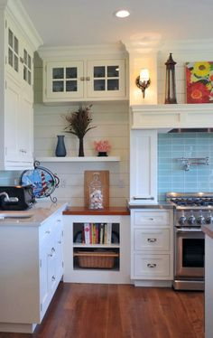 House of Turquoise: Susan Serra love the shiplap panels and blue tile, cookbook shelf and basket storage.