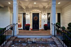 Stylish Black Front Doors – Change Your House's Curb Appeal.  Love the front porch entry!