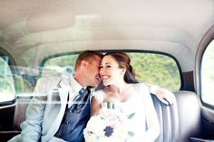 bride and groom in the getaway car