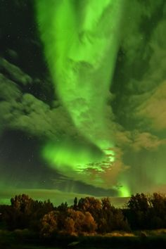 Photographer and nature enthusiast Christopher Amstutz captured these incredible photographs of the Northern Lights last night. Also known as Aurora borealis, these bright, ethereal lights are caused by collisions between electrically charged particles from the sun that enter the earth's atmosphere. The lights are often seen above the northern and southern poles in colors of green and pink, and less frequently red, blue and yellow.