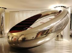 Cool Rounded Lobby Reception desk of Trendy Boutique Hotel Interior design by Ron Arad Associates in Rimini-Italy