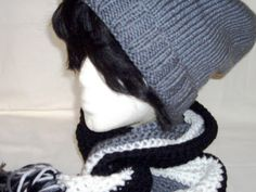 "This is a beautiful hat and scarf set. Elegant and classic.  The colors are Grey,White and Black.  FEATURES:The hat is knit, with a generous 2"" ribbing and lots of slouch. The scarf is crocheted vertically, the colors are pleasingly arranged.  Great for adults or teens.  The set is warm and cozy.OPTIONS:Not the right color for you"