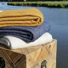Stunning combination of these mustard wool blanket and the navy Fishbone wool blanket.  www.ruralurban.co.uk