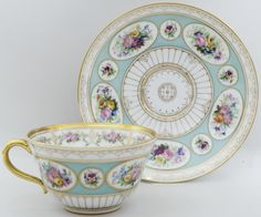 Cup with saucer Flowers. Imperial Porcelain Factory. Period of Aleksander II (1855-1881). Porcelain, painting, gilt. Marks in green II, on the cup, over green - blue over glaze mark in a blue wreath. Height of cup 5,2 cm. Diameter 14,5 cm
