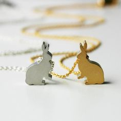 Silver and gold. Bunny necklaces. Cute.