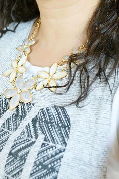 Bloom & Grow - Jewel Statement Necklace - A gorgeous gold statement necklace featuring gems in ivory and light gray with rhinestones in a floral shape. This beautiful necklace can be work with a casual or informal outfit and both will look amazing when paired with this necklace. Gold chain. Measures 20 inches + 3 inch extension for additional length.