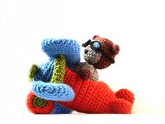 This Airplane and Pilot Cat pattern is not free but they have lots of free ones at AmigurumiPatterns.net