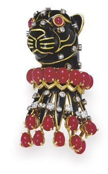 A diamond, ruby, coral and enamel panther brooch, by David Webb. Designed as a black enamel panther, with gold stripes and cabochon ruby eyes, with an oval cabochon coral collar, his body decorated with collet-set and circular-cut diamond spots, suspending an articulated fringe of oval cabochon coral, mounted in 18k yellow and white gold. Signed Webb for David Webb