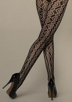 6f26fde9cf1c0 Yelete Stella Elyse ZIG ZAG COILS FISHNET PANTYHOSE with tiny circular cut  out shapes are outlined