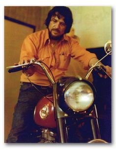 Guernsey's Auctioneers & Brokers Since 1975...Waylon Jennings on Buddy Holly's Ariel Cyclone motorcycle presented to Jennings after Holly's death.