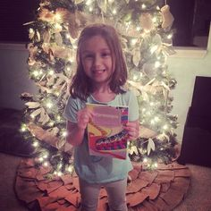 I love this picture of Isabella by the tree! Thanks @lindsaylifecoach!  #books #childrensbooks #christmas #christmastree #booksforkids #holidays #scholastic #kids #instakids #adorable #kidsreading #elementary #igkids #kidsstyle