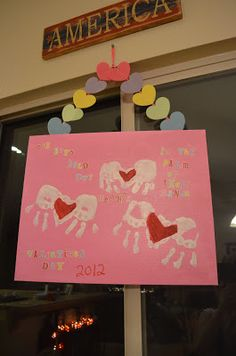 """Valentines day hand print kids craft, says """"our boys hold our hearts in the palm of their hands"""""""