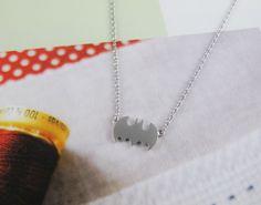 small silver Batman necklace silver. $13.00, via Etsy.