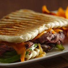 Philly Cheesesteak Panini Recipe - Allrecipes.com- using Pillsbury refrigerated French bread