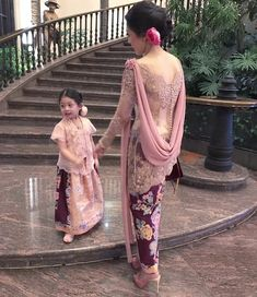 Image may contain: 1 person Kebaya Pink, Kebaya Lace, Kebaya Brokat, Kebaya Dress, Batik Kebaya, Batik Dress, Gaun Dress, Dress Pesta, Party Gowns