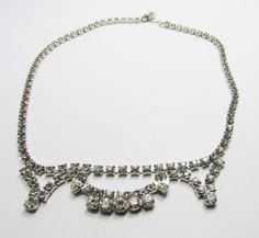Pretty Vintage 1950s Rhodium Plated Clear Rhinestone Necklace by GildedTrifles on Etsy https://www.etsy.com/listing/477139838/pretty-vintage-1950s-rhodium-plated