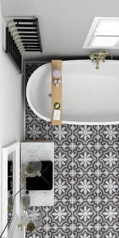 12 grey and white porcelain tiles create an eye-catchy touch in this bathroom…