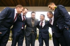Groom with groomsmen huddled up - shot by Rachel Pray | Ashley Gerrity Photography :: Woodcrest Country Club Wedding