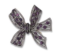 AN AMETHYST AND DIAMOND BOW BROOCH, BY MICHELE DELLA VALLE  The openwork bow millegrain-set with brilliant-cut diamonds and cushion-shaped amethyst, mounted in blackened gold