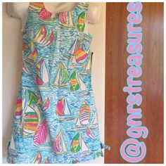 """LILLY  PULITZER REGATTA  DRESS  32"""" top to bottom - new. Great dress. Hot pink zipper in the back. Little bows on each side at the bottom - size 4. Lilly Pulitzer Dresses Midi"""