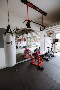 Half Garage Gym On a Budget - Uptown with Elly Brown Home Gym Garage, Diy Home Gym, Gym Room At Home, Home Gym Decor, Basement Gym, Man Cave Garage, Garage House, At Home Crossfit Gym, Garage Gym Flooring
