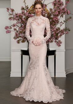 Blush La Vie en Rose lace gown, with sweetheart neckline and fluted skirt. Gown shown with a fitted illusion blouse.