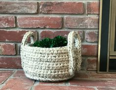 This textured crochet basket brings casual, decorative style to home organization. The perfect storage basket to warm up your rustic home decor. Useful in practically any room of your home where you need a bit of extra storage, or to simply add a decorative touch. #hygge #hyggedecor #storagesolutions