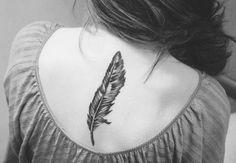 snowy owl feather tattoo