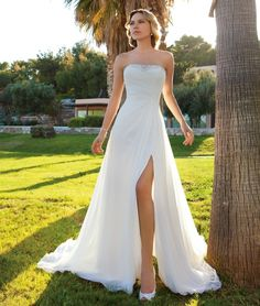 Destination Romance Style DR201 by Demetrios Chiffon Strapless, A-line destination wedding gown with a ruched, wrap bodice, beading on neckline, and Chiffon cape. The skirt on this bridal dress features a high side slit and Chapel Train. www.demetriosbride.com