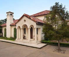 The front porches of Mediterranean-style homes are often defined by stone columns spanned by arches. Roofs feature wide, overhanging eaves with large brackets under the roofline. A variety of new terra-cotta tiles top this stucco home, mimicking the look of reclaimed Italian tile without sacrificing durability.