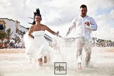 Running in the ocean with our wedding dress. Unique Beach Trash the Dress Ideas. MTM Photography. Playa del Carmen Photographer. Beach Wedding Ideas. Riviera Maya Top Photographers. TTD