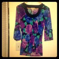 LOFT Floral Bell Sleeve Blouse LOFT Floral Bell Sleeve Blouse. Re-poshing...love this top just not on me . GORGEOUS floral print! Made of 95% polyester and 5% spandex. True to size! Open to offers! LOFT Tops Blouses