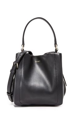 DKNY . #dkny #bags #shoulder bags #hand bags #leather #bucket #