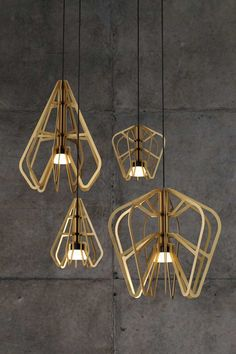 Laser cut lampshades with interesting light bulbs.