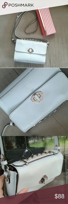 Rebecca minkoff mini blake mint Mini Blake bag in mint color Has some markings on front otherwise in excellent condition! Strap looks now with no cracks in leather. No dust bag  A structured leather bag in with glossy oxblood edges. To use the bag as a clutch, tuck in the adjustable strap and carry it by the studded handle. A turn lock opens to the unlined interior.   Leather: Cowhide. Weight: 18oz / 0.51kg. Imported, China.  MEASUREMENTS Height: 6in  Length: 8.25in  Depth: 2in  Strap drop…
