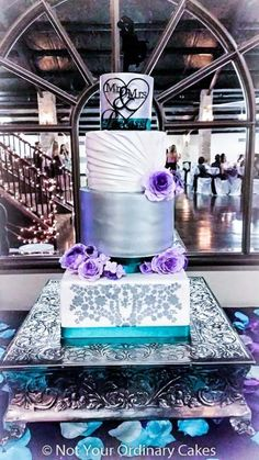 Teal and purple wedding cake by Not Your Ordinary Cakes - http://cakesdecor.com/cakes/223949-teal-and-purple-wedding-cake #TealWeddingIdeas #weddingcakespurple