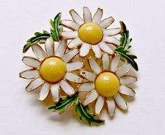 Vintage Weiss Enamel Daisy Pin. Three Daisies in a circle pattern with white, yellow and green enamel.  Working C clasp. Great pin!  +Condition: Very Good. Enamel loss peta... #vintagepaige