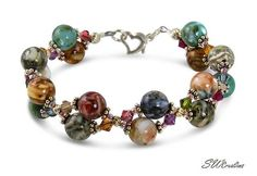 Handcrafted stunning 6 1/2 inch mother of pearl crystal beaded bracelet created with colorful Mother of Pearl beads, Swarovski Austrian crystals and sterling.
