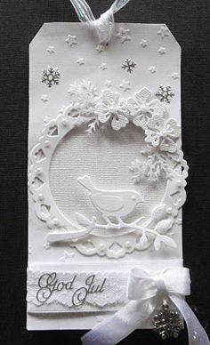 delightful handmade Christnas tag ... all white ... die cut wreathwith flowers & a bird ...