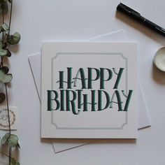 """The black hand lettered """"Happy Birthday"""" sits boldly in the centre of the card, with green shadowing. This simple design is accompanied by a green square border which helps it to really stand out. Happy Birthday Cards, White Envelopes, Simple Designs, Card Stock, Centre, Banner, Calligraphy, Journal, Green"""