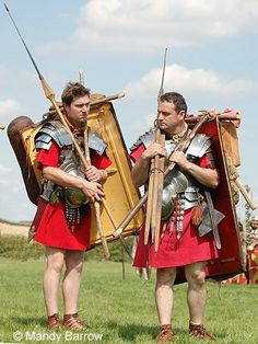Roman soldiers carry their equipment