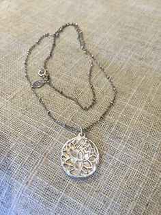 Handmade Fine Silver Lotus Blossom on Sterling Silver Chain from White Gardenia Designs on Etsy. $50