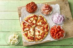 Our family-friendly pizza recipe is guaranteed to get your kids (even the picky eaters!) into the kitchen and excited about what's cooking. After all, who doesn't love a pizza party? Your little helpers can salt the marinara sauce,  stretch the dough, and load on ALL the toppings they want.