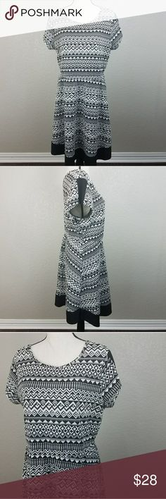 Paperdoll black white Aztec geo print dress 1X Paperdoll black white Aztec geo print dress size 1X  Length - 37 inches Chest - 21 inches (measured flat)  Photos are the description of this article. Any flaws will be pointed out and noted. Otherwise this article is in excellent condition. Paperdoll Dresses