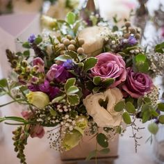 Wedding flowers - Botanica Flowers. Lilac and white table centre piece including roses, lisianthus, snapdragons, silver brunia, lavender, pittysporum, limonium and gypsophila.