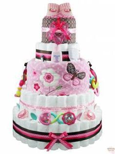 This site has a ton of cute diaper cakes! I'd probably just use it for inspiration and make my own cheaper versions though. xD