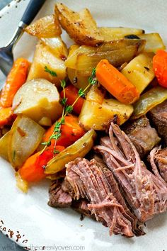 Balsamic vinegar, caramelized onions, and plenty of other veggies make this tender pot roast unbelievably flavorful and the easiest weeknight winter dinner!