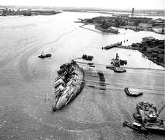 Righting operations on the capsized USS Oklahoma at Pearl Harbor in March, 1943. U.S. NAVY