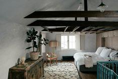 Serene bedroom with exposed beams